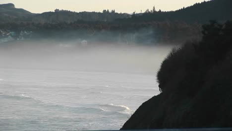 Longshot-Of-Ground-Fog-As-The-Ocean-Waves-Roll-In-On-The-Oregon-Coast