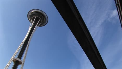 A-Wormseye-Angledview-Of-Seattle-S-Space-Needle-And-The-Underside-Of-The-Monorail-That-Runs-Nearby