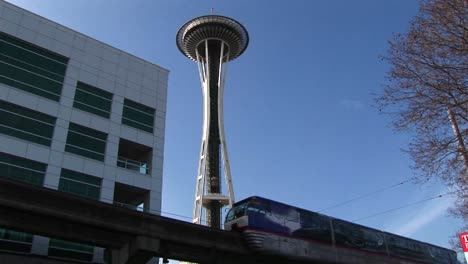 A-Closeup-Of-The-Monorail-Passing-By-Seattle-S-Landmark-Space-Needle