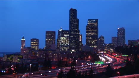 Traffic-Creates-Solid-Streams-Of-Light-As-Cars-Move-Along-A-Multilane-Seattle-Expressway