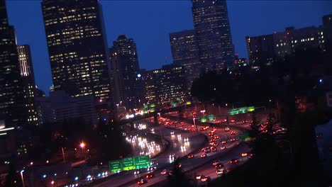 A-Closeup-Of-Downtown-Seattle-Buildings-With-Heavy-Traffic-Flowing-Along-Major-Expressways