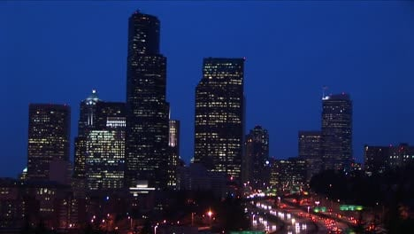 Long-Shot-Of-A-Group-Of-Seattle-S-Skyscrapers-Towering-Above-An-Innercity-Expressway