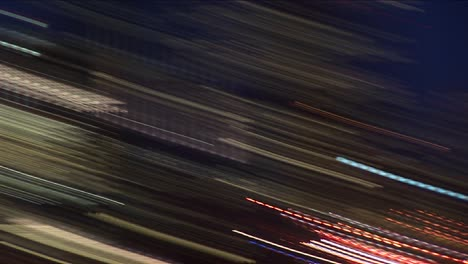 A-Handheld-Camera-Zooms-In-And-Out-Creating-Abstract-Often-Explosive-Images-Of-Seattle-At-Night