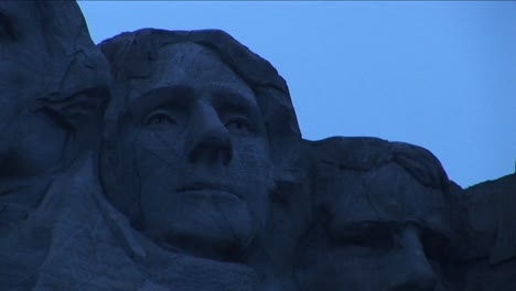 Thomas-Jefferson-Is-Flanked-By-George-Washington-On-His-Left-And-Theodore-Roosevelt-On-His-Right-In-This-Extreme-Closeup-Detail-Of-Mt-Rushmore