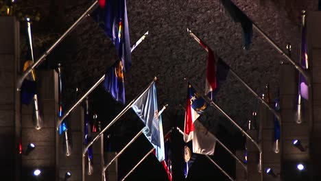 The-Camera-Pans-Up-The-Avenue-Of-Flags-To-Mt-Rushmore-At-Night-In-Lights