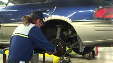 A-Mechanic-Pulls-Repeatedly-On-A-Wheel-S-Axle