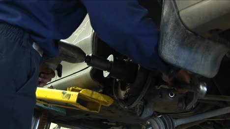 A-Mechanic-Works-On-A-Wheel-Repair-With-A-Variety-Of-Tools