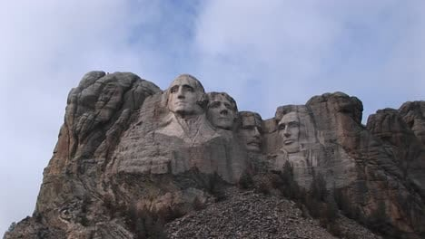 Clouds-Drift-Slowly-Past-The-Tops-Of-The-Four-Presidents-In-This-Longshot-Of-Mt-Rushmore