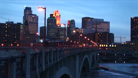 Mediumwideshot-Of-Minneapolis-Minnesota-Skyline-From-The-Mississippi-River-During-The-Goldenhour
