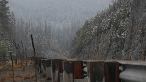 A-Scenic-Look-At-Mountain-Snow-Storm-From-The-Roadside-Safety-Barrier