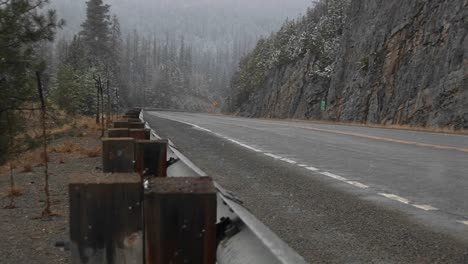 A-Look-At-A-Quiet-Mountain-Road-During-A-Winter-Snowstorm