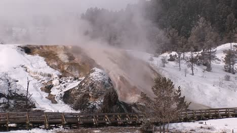 Mist-Rises-From-Yellowstone-National-Park-S-Hot-Springs-Terraces-In-Winter