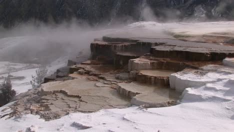 Steam-Rises-From-This-Hot-Springs-Terrace-Covered-With-Snow