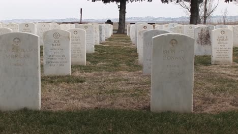 The-Camera-Pans-An-Old-Military-Cemetery-With-White-Headstones-Arranged-In-Precise-Rows