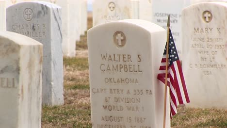 An-American-Flag-Decorates-The-Headstone-Of-A-Fallen-Hero-At-Arlington-National-Cemetery