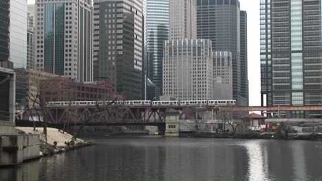An-Attractive-Look-At-Chicago-With-Modern-Skyscrapers-In-The-Background-Elevatedtrains-And-The-River-In-The-Foreground