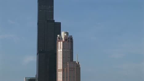 Camera-Pans-Two-Impressive-Skyscrapers-From-Street-Level-To-The-Aerial-Towers-On-Top-Of-The-Sears-Tower-In-Chicago