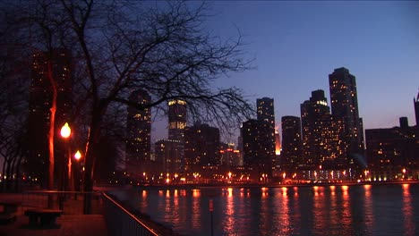 Skyline-Reflections-Of-Chicago-Shimmer-In-The-Water-Of-Lake-Michigan