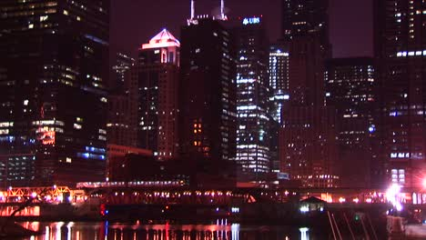 Chicago-S-Buildings-Sparkle-At-Night-As-A-Commuter-Train-Moves-Across-The-City