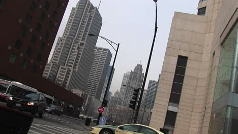 An-Angled-Shot-Of-Downtown-Buildings-With-Moving-Traffic