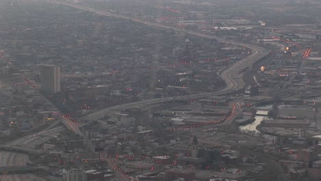 A-Aerial-Shot-Of-A-Freeway-And-Surrounding-Metropolitan-Area