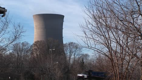 The-Camera-Pans-From-The-Front-Porch-Of-A-Residential-Home-To-A-Nuclear-Power-Plant-Located-Nearby