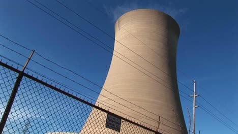 A-Nuclear-Power-Plant-Is-Protected-By-A-High-Cyclone-Fence-And-Barbedwire