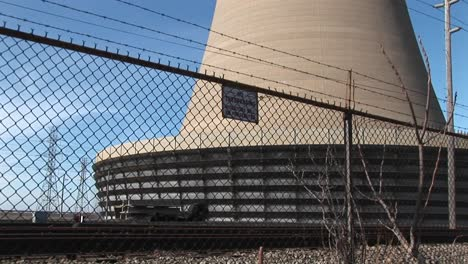 The-Camera-Pans-From-The-Base-Of-A-Nuclear-Power-Plant-To-The-Top-Of-Its-Curved-Structure
