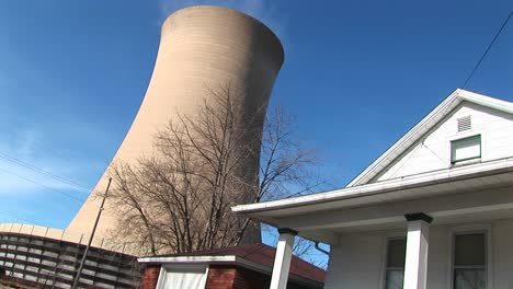 The-Huge-Cone-Of-A-Nuclear-Power-Plant-Looms-Above-A-Home