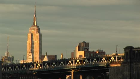 The-Empire-State-Building-Rises-Above-The-Surrounding-Buildings-And-Freeway-In-The-Foreground