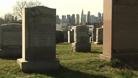 The-Camera-Pans-Back-And-Forth-In-This-Cemetery-With-The-Skyline-Of-New-York-In-The-Background