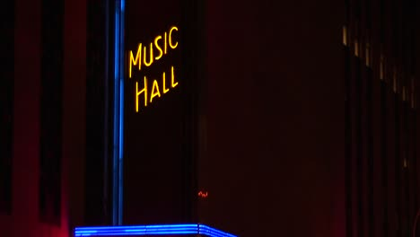 The-Camera-Pans-Up-The-Neon-Illuminated-Radio-City-Music-Hall-Marquee-At-Night