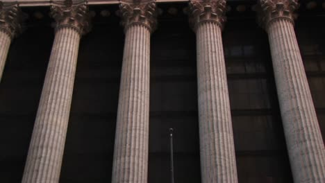 The-Camera-Pans-Up-The-Columns-Of-The-New-York-Stock-Exchange-Building-To-The-Inscription-And-Frieze-At-The-Top