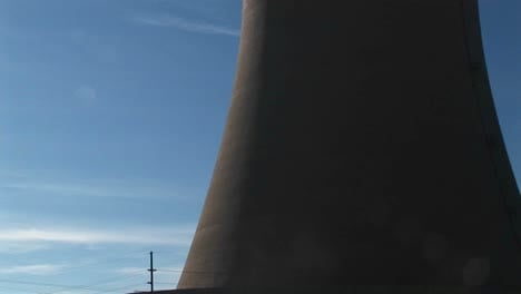 The-Camera-Pans-From-The-Base-To-The-Top-Of-A-Nuclear-Power-Plant
