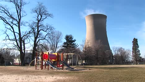 A-Children-S-Colorful-Playground-Is-Seen-In-The-Foreground-With-A-Nuclearpower-Plant-In-The-Background