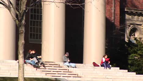 Students-Sit-On-The-Steps-Of-The-Church-At-Harvard-University