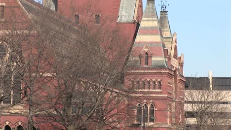 Students-Walk-Across-Campus-As-The-Camera-Pans-Up-One-Of-Harvard-S-Churches