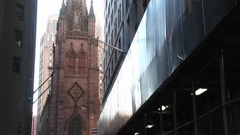 Pan-Up-On-An-Old-Catholic-Church-In-Downtown-New-York
