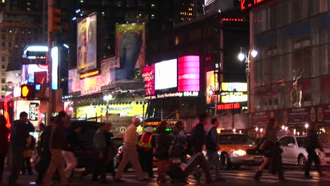 Mediumshot-Of-Times-Square-With-Pedestrians-And-Turning-Traffic