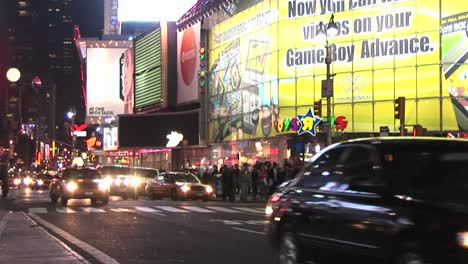 The-Streets-Are-Full-Of-People-After-Dark-In-This-Downtown-Shot-Of-New-York