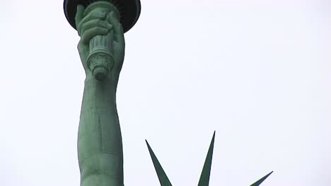 The-Camera-Pans-From-The-Head-And-Crown-Of-The-Statue-Of-Liberty-Up-To-The-Torch