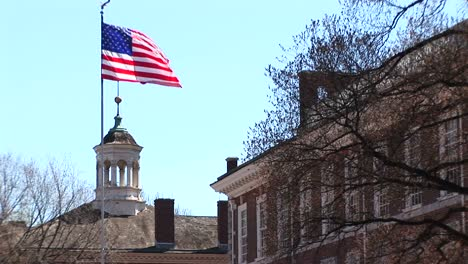 The-Camera-Pans-Up-A-Flagpole-To-The-Top-Where-The-American-Flag-Is-Flying-In-Front-Of-Independence-Hall-In-Philadelphia