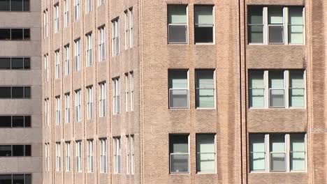 The-Camera-Zooms-In-To-A-Close-Look-At-Two-Windows-In-A-Large-Building
