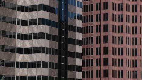 An-Interesting-Look-At-The-Colors-And-Patterns-Two-Highrise-Buildings-And-Their-Windows-Make-When-Shown-Next-To-Each-Other