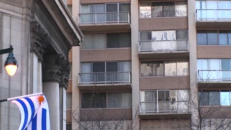 The-Camera-Zooms-In-On-Windows-And-A-Balcony-Of-A-Large-Residential-Hotel-In-A-Major-City