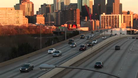 The-Camera-Pans-Up-From-A-Divided-Highway-To-Chicago-S-Skyline-At-The-Golden-Hour