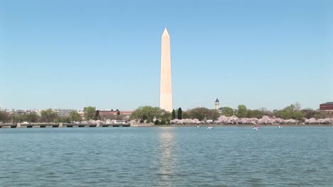 The-Washington-Monument-Reflects-Across-A-Shimmering-Body-Of-Water