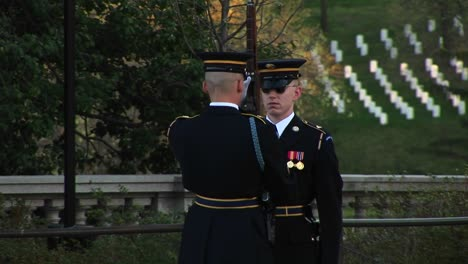 A-Soldier-Stands-At-Attention-In-Full-Uniform-As-Another-Soldier-Inspects-His-Gun