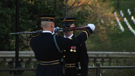 A-Soldier-Finishes-Inspecting-Another-Soldier-S-Gun-And-Hands-It-Back-To-Him