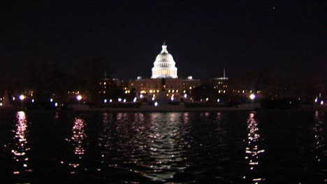 The-Capitol-Dome-Is-Illuminated-As-A-Reflecting-Pool-Shimmers-Below
